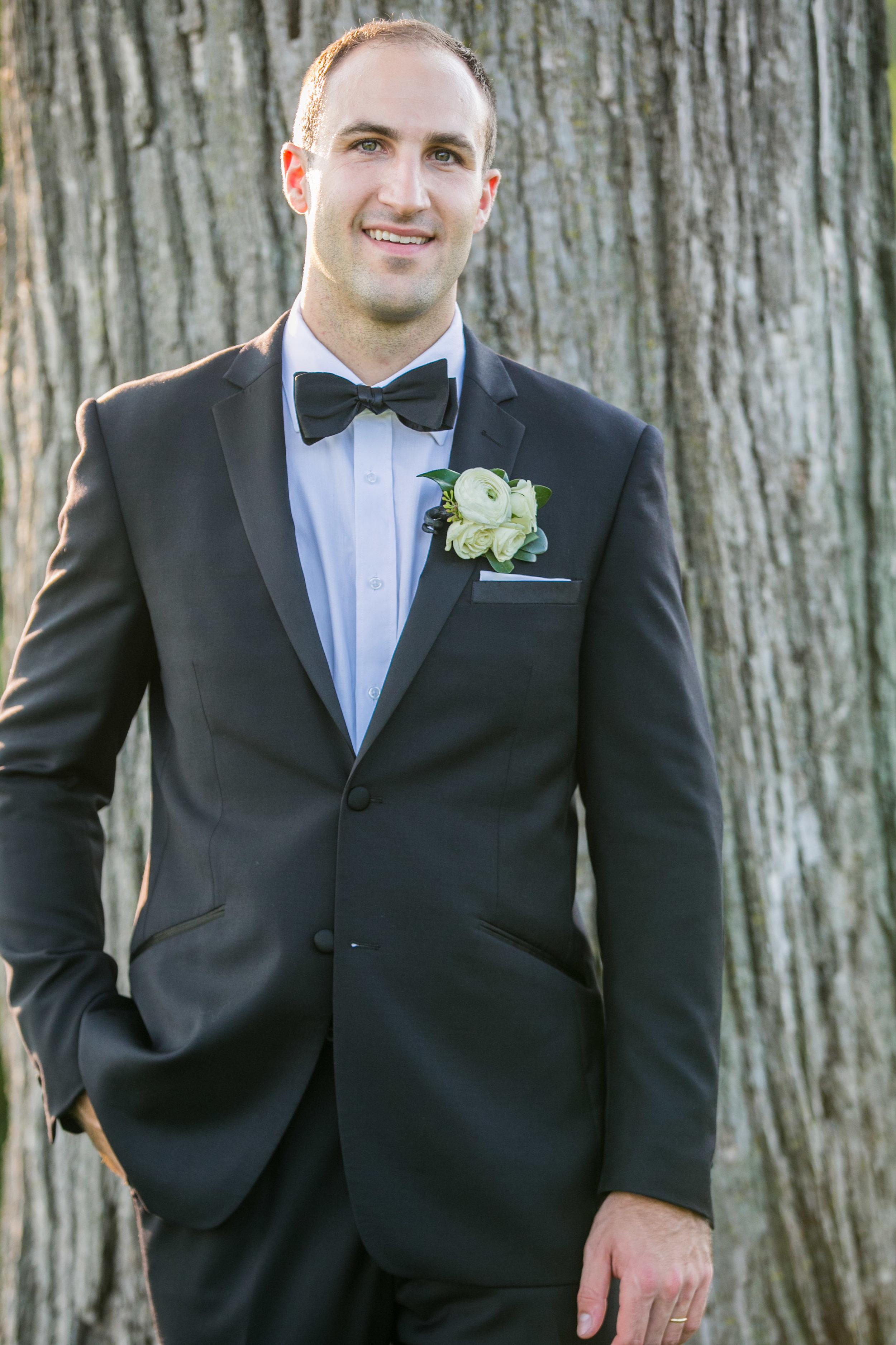 groom portrait shot outdoors