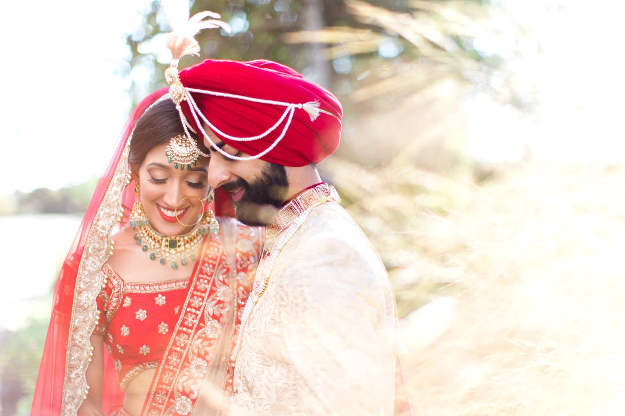 Bride and Groom laughing during their outdoor creative session