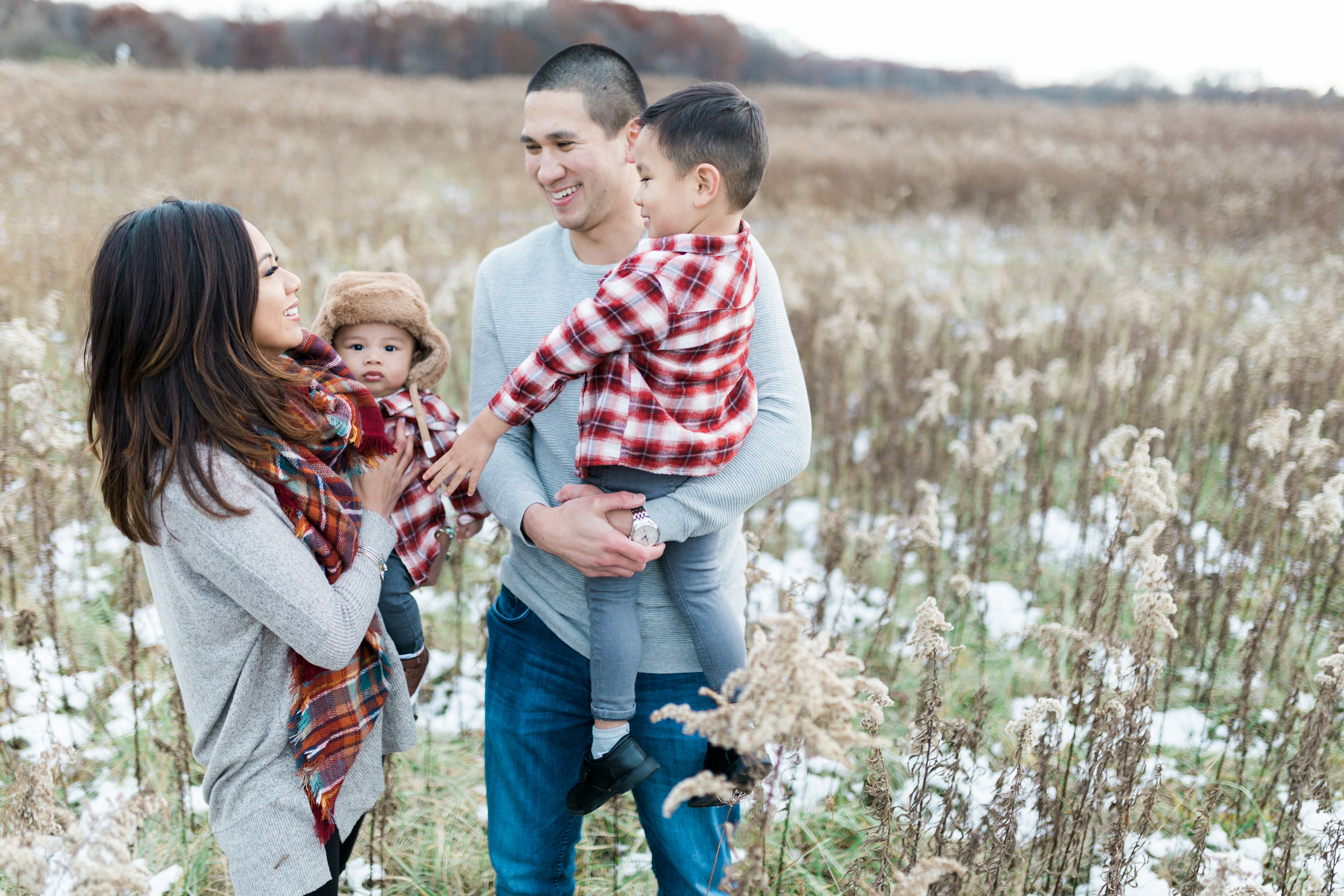 Family session laughing with each other in the field