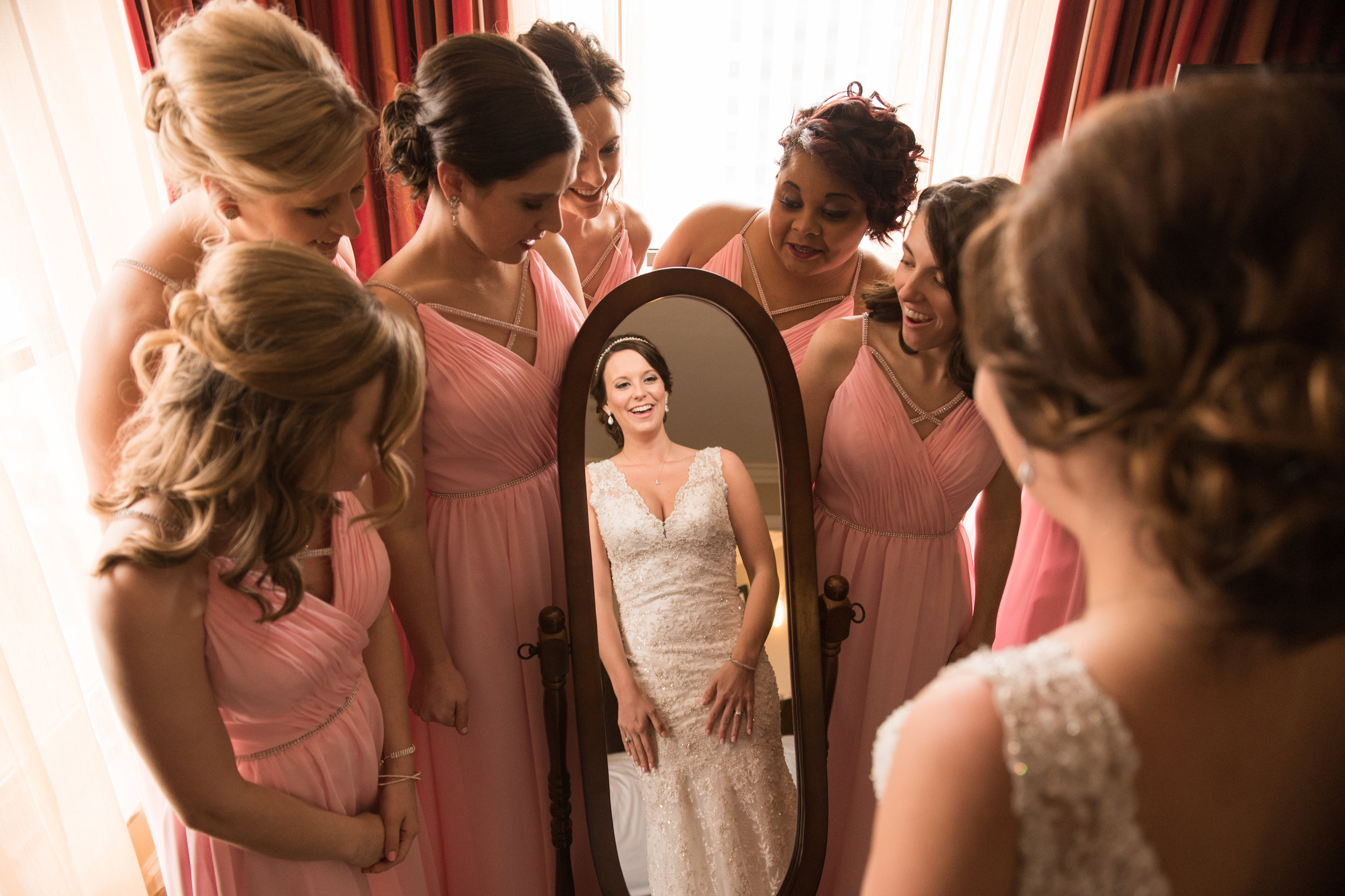 bride-bridesmaids-mirror-getting-ready-reflection-pink-dresses.jpg