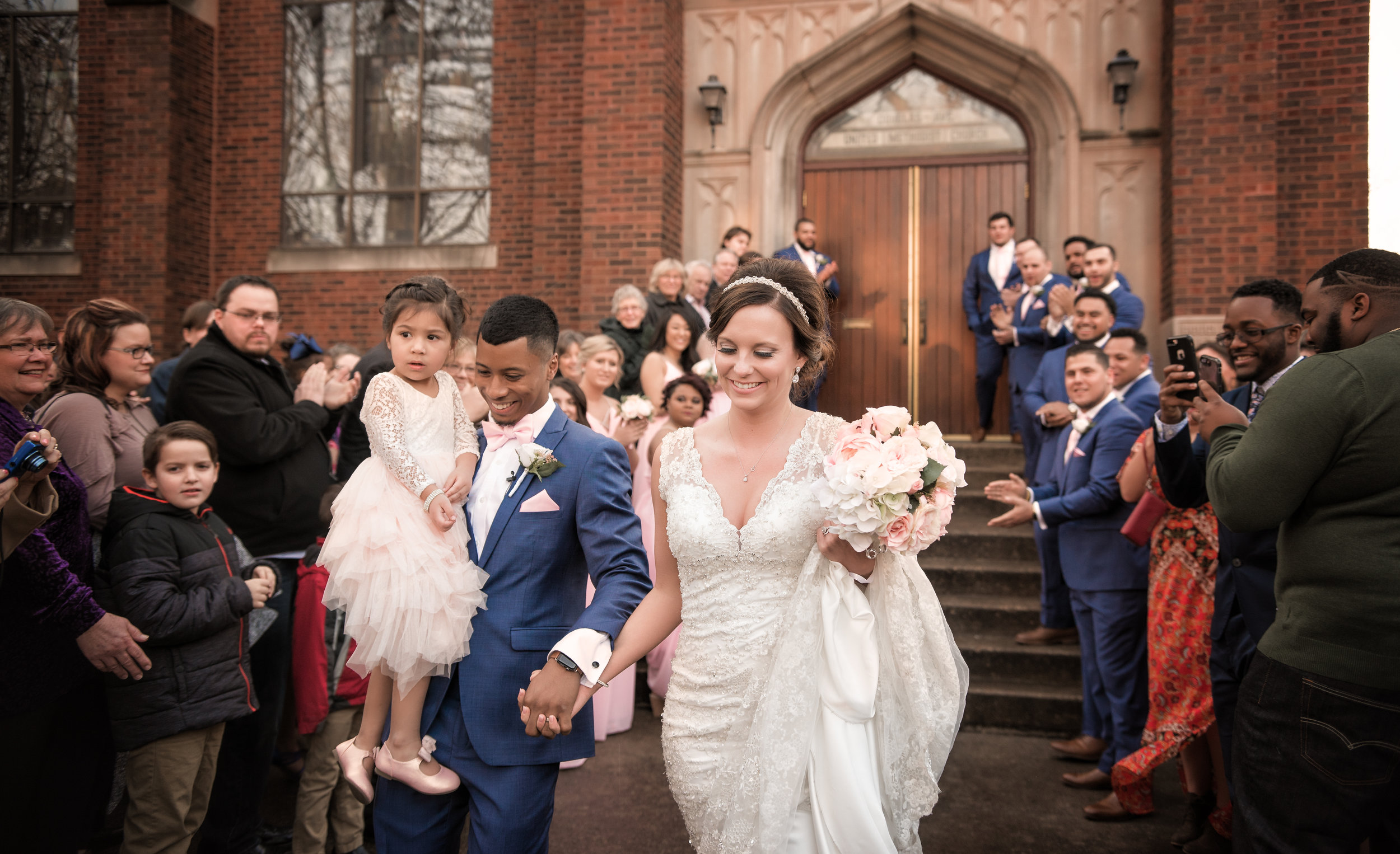 bride-groom-flower-girl-church-steps-crowd-cheering.jpg