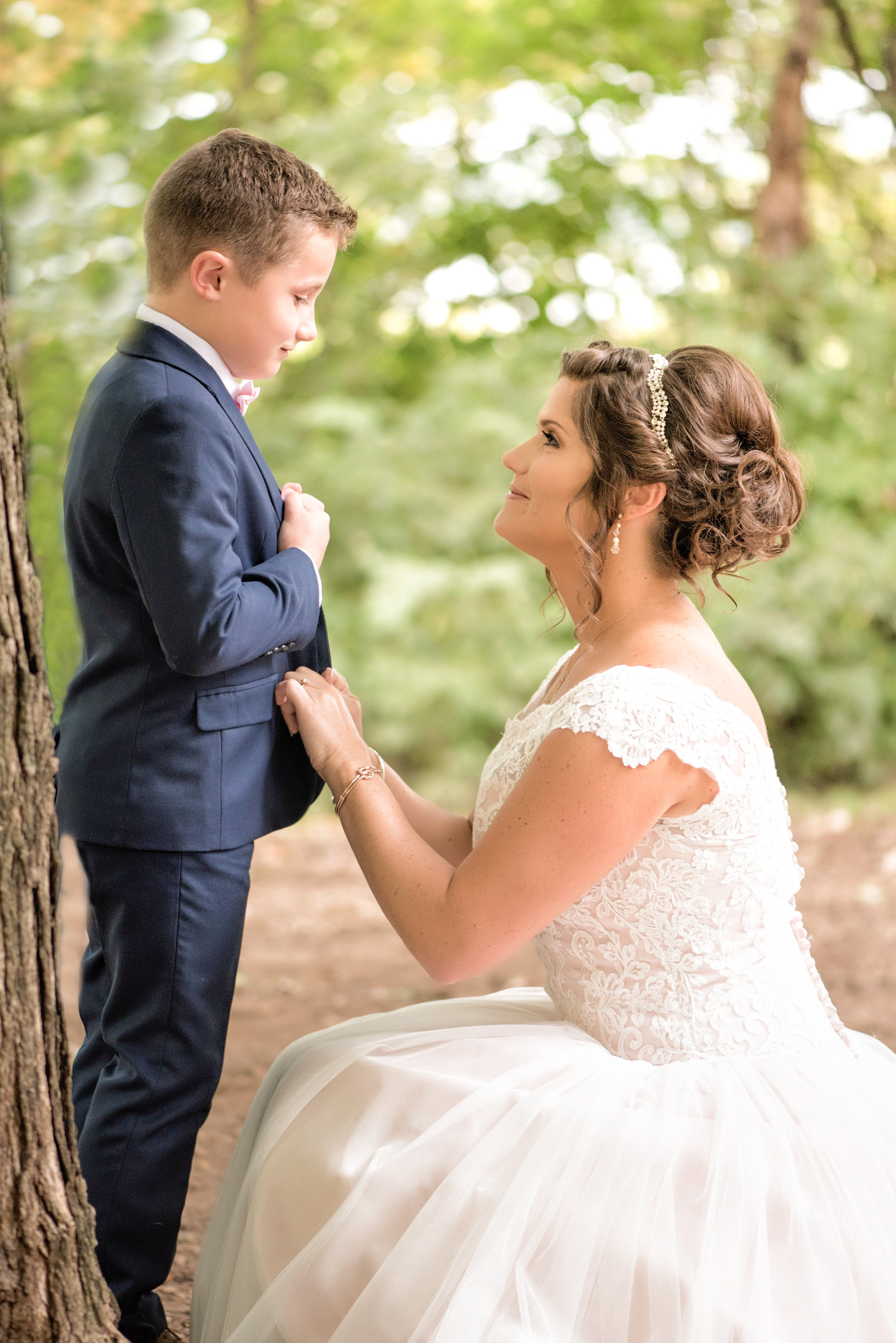bride-ring-bearer-outdoors-forest-trees-bark-getting-ready.jpg