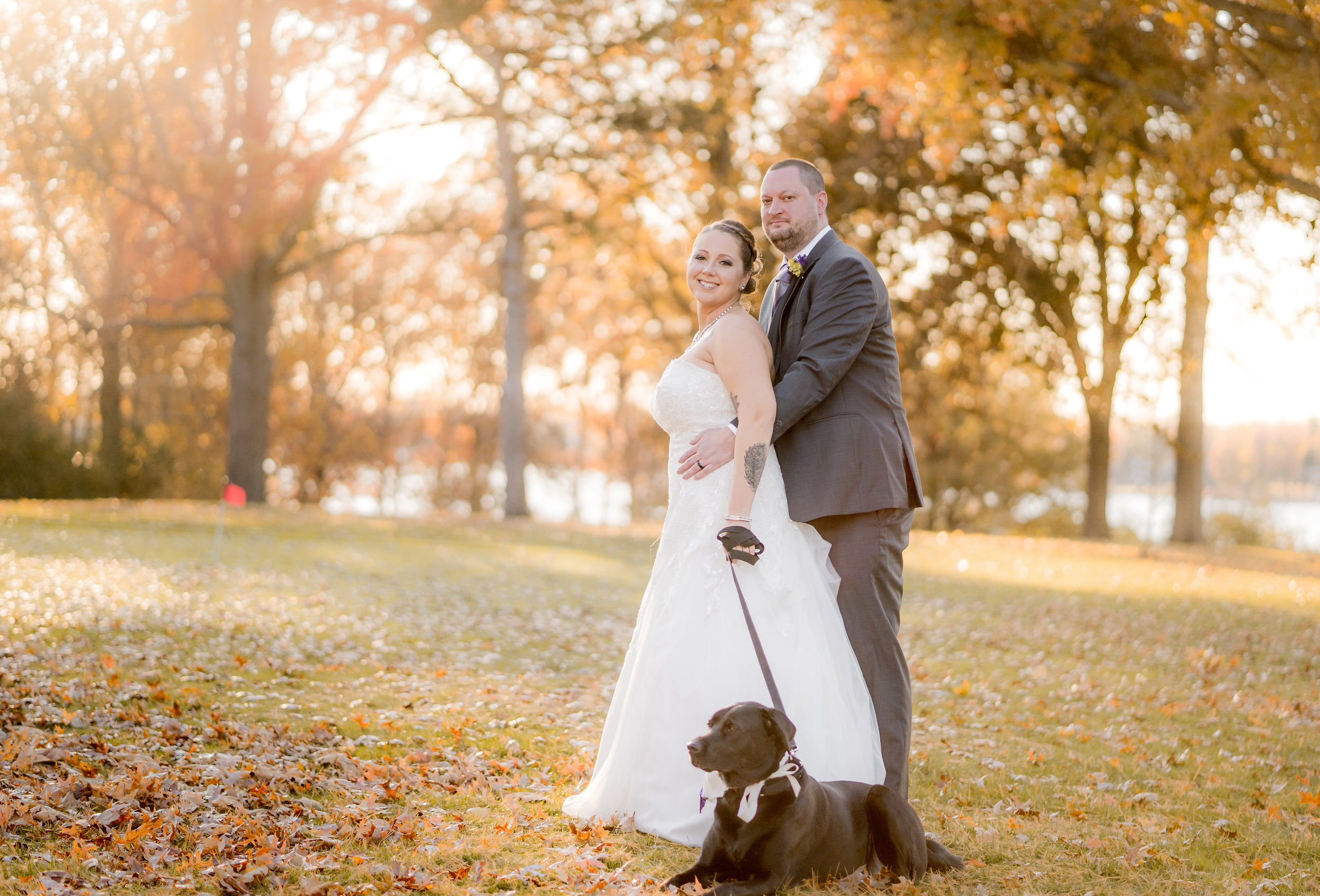 fall-autumn-wedding-bride-groom-outdoors-black-lab-dog.jpg