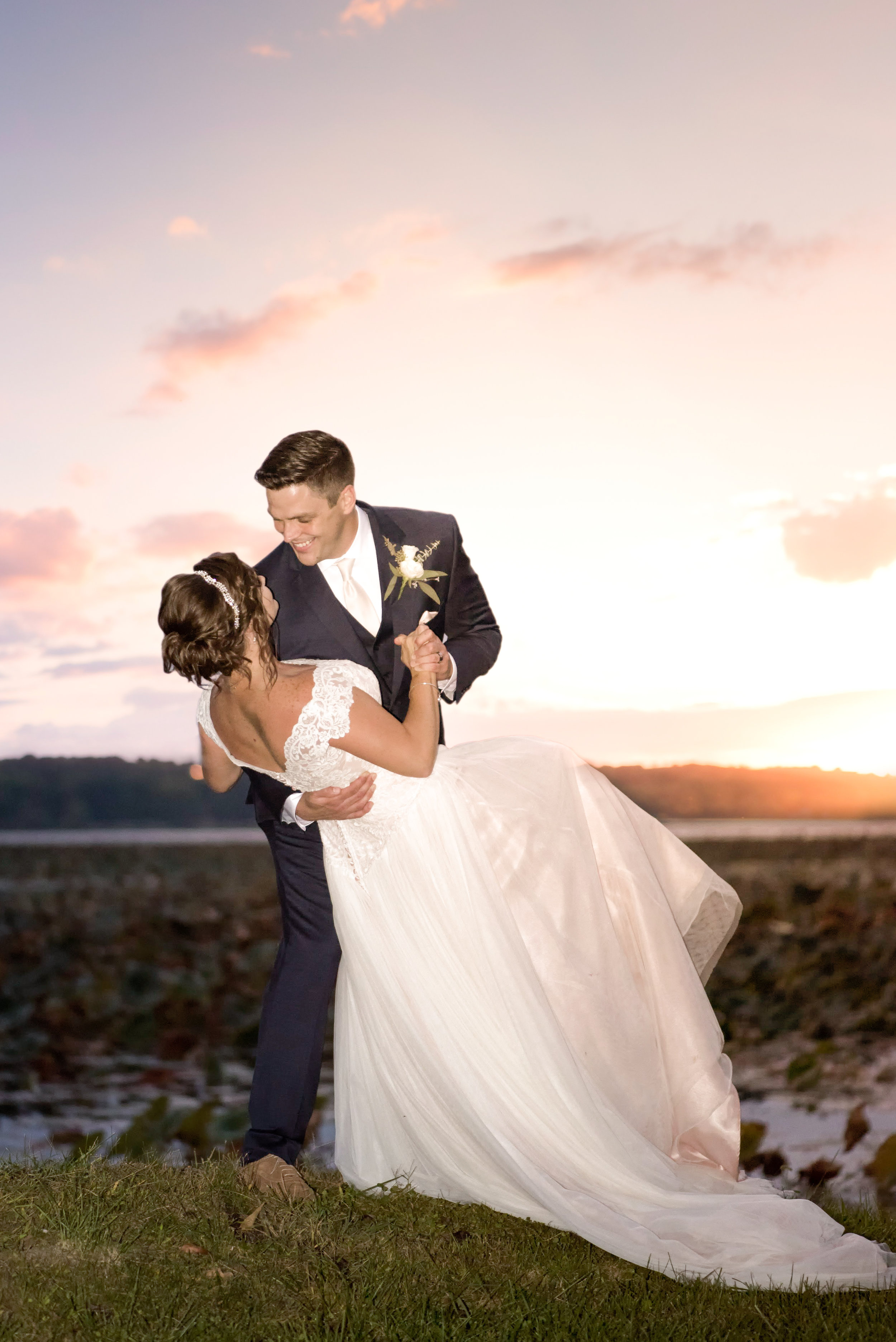groom-sweeping-bride-off-her-feet-beautiful-sunset.jpg