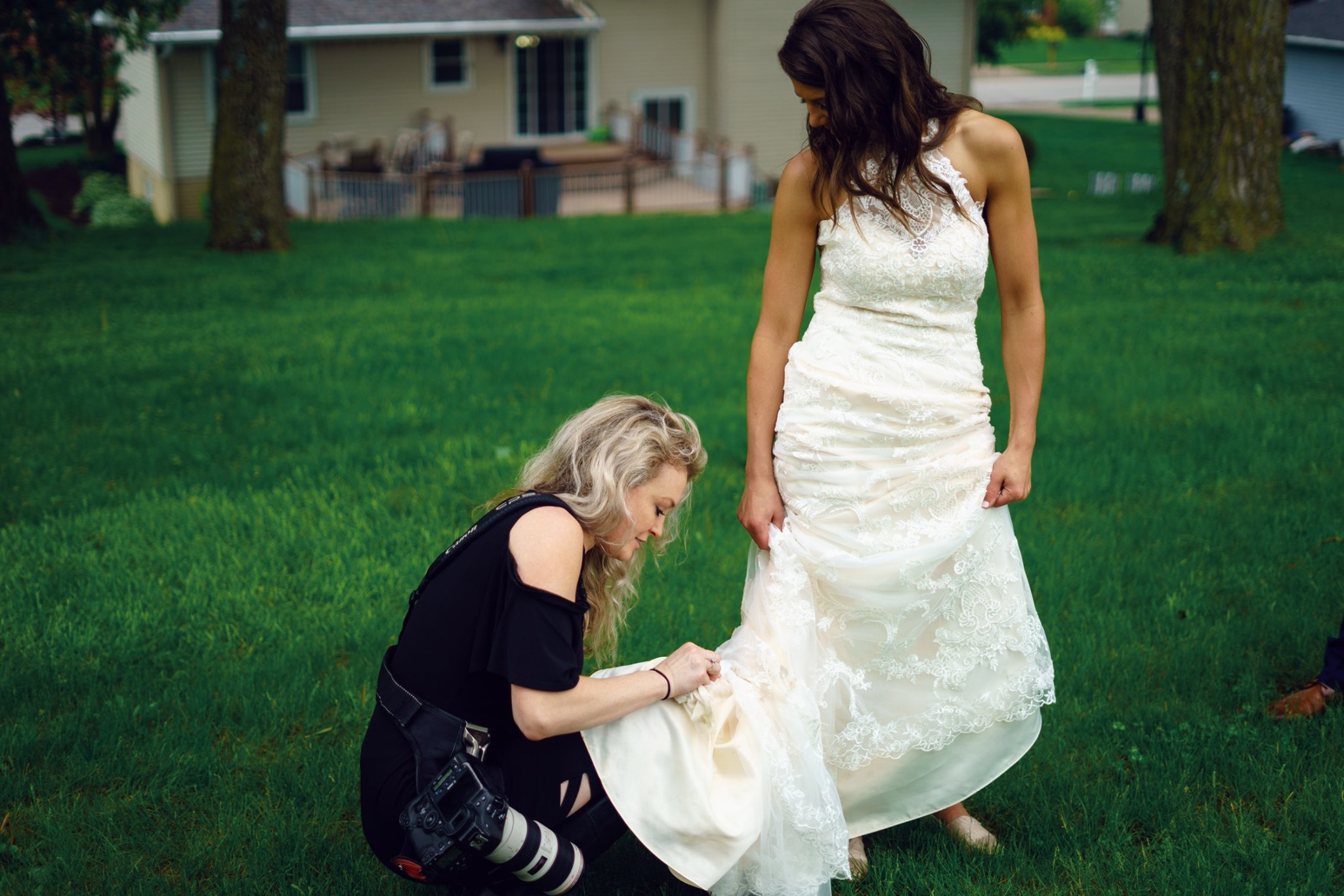 lauren-ashley-wedding-photography-photographer-cleaning-mud-off-dress.jpg