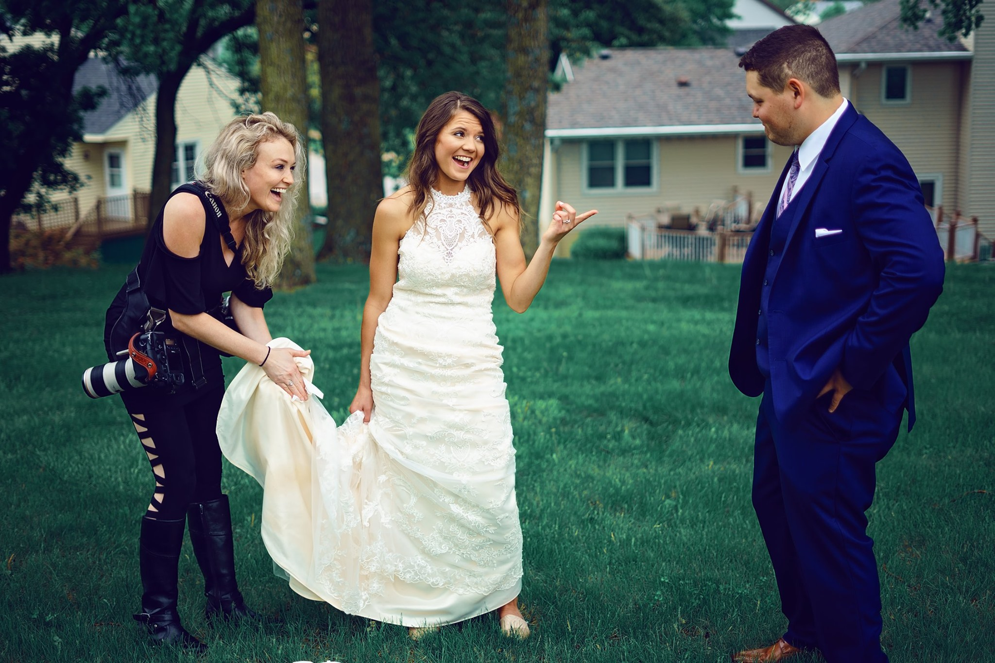 lauren-ashley-wedding-photography-photographer-cleaning-mud-off-dress.-blame-groom.jpg