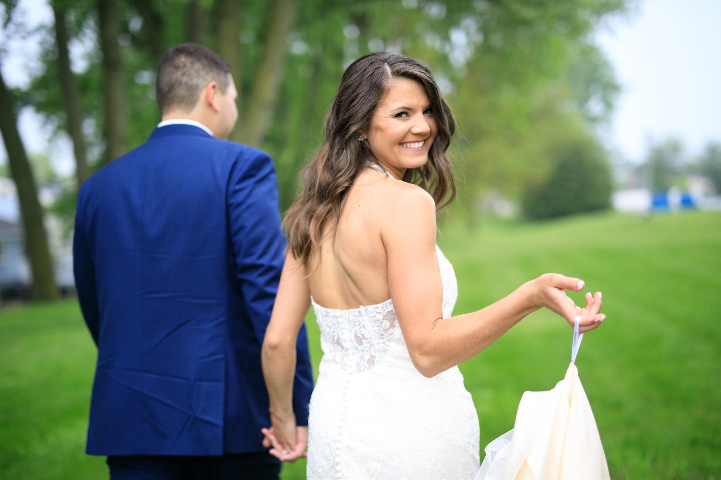 Cute-bride-walking-with-groom-in-quad-cites.jpg