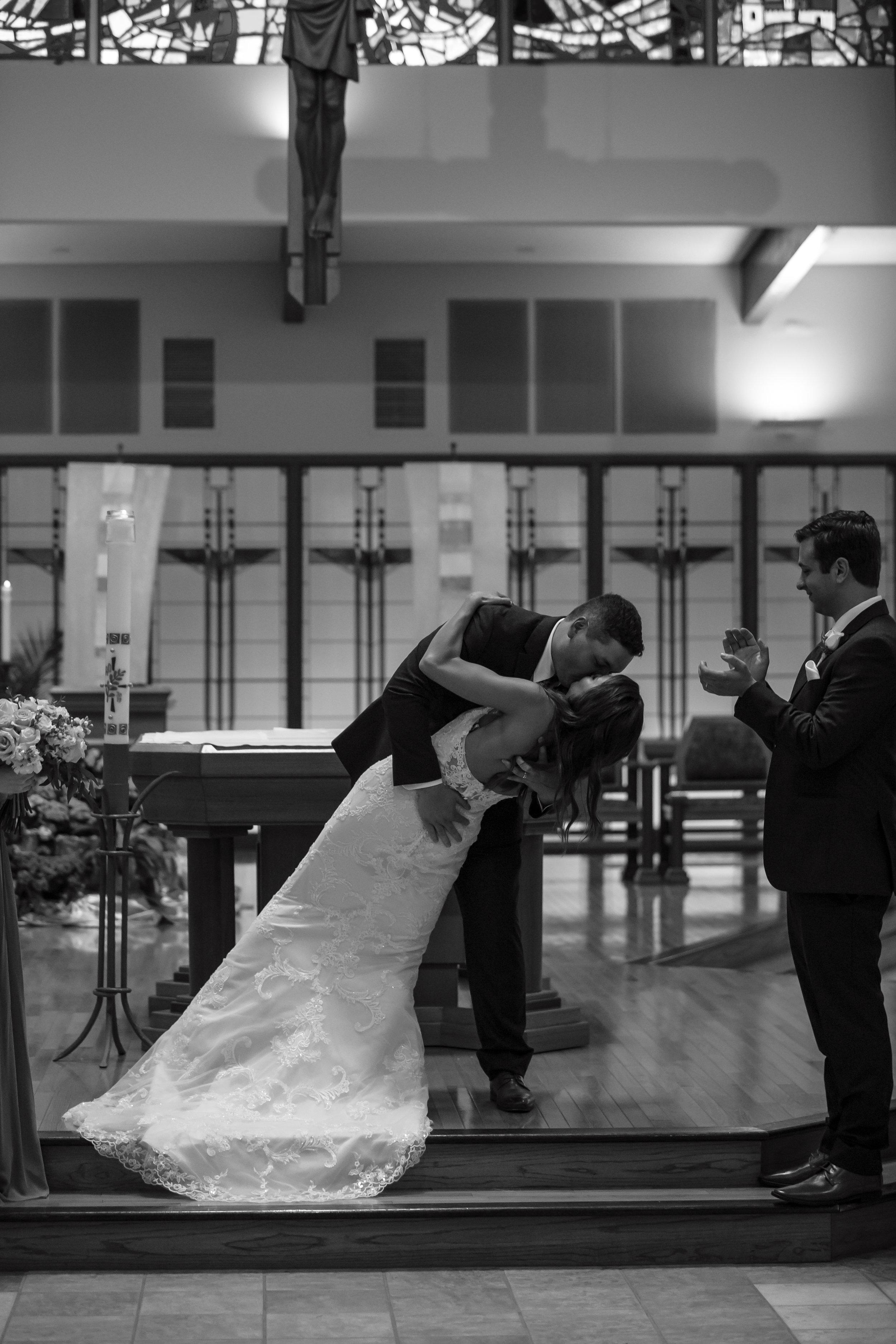 Bettendorf-wedding-kiss-St-John-Vianney-Church.jpg