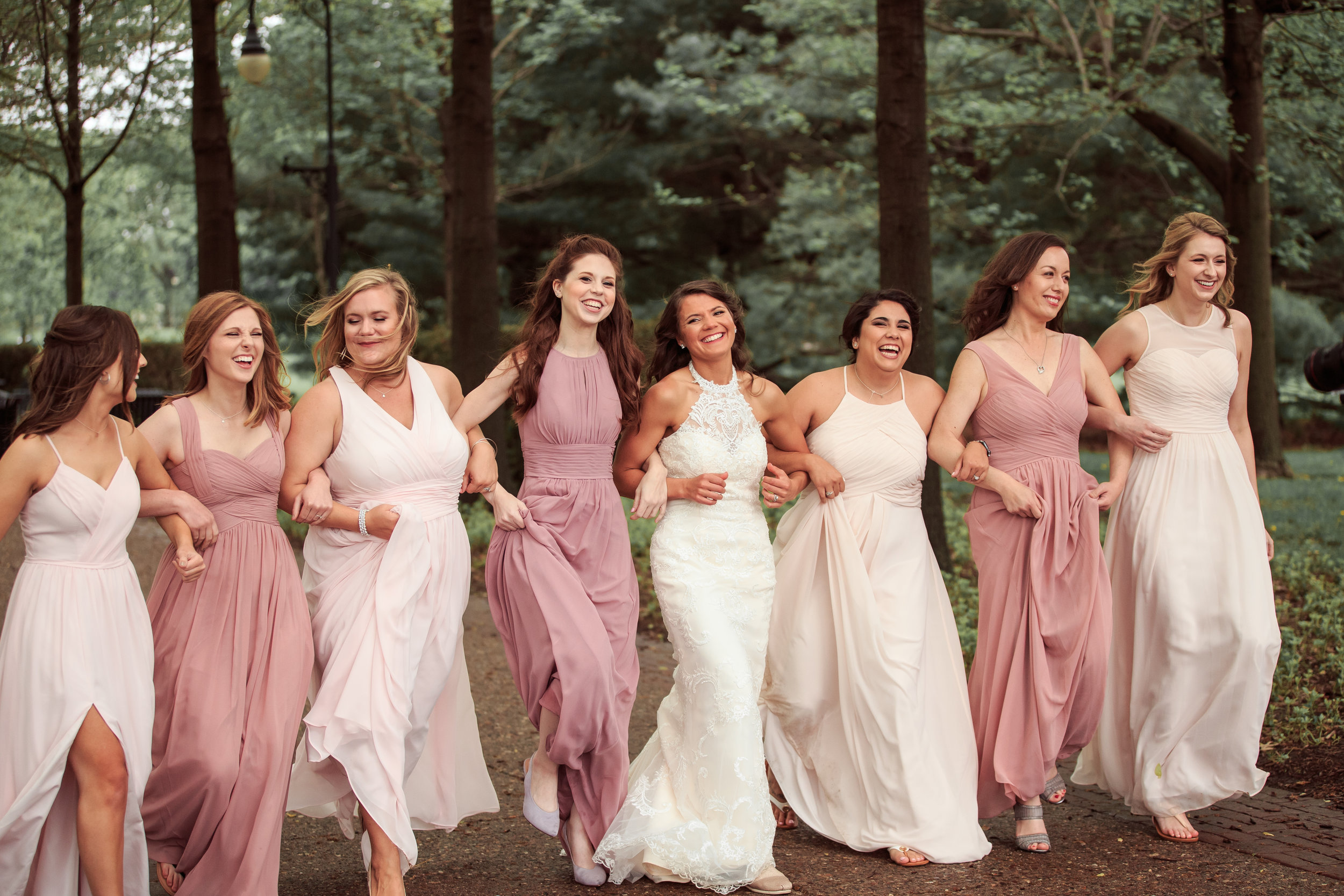 Fun-bridesmaids-skipping-laughing-wedding-photo.jpg