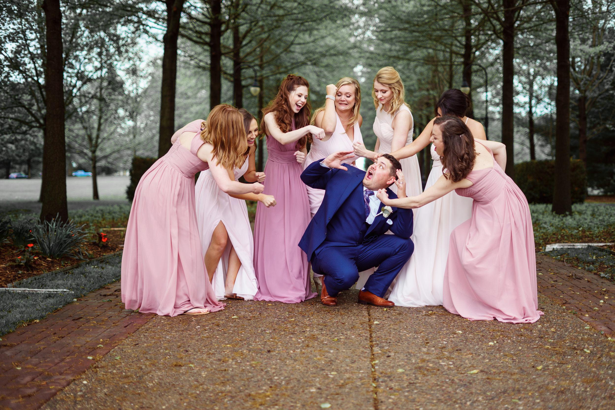 Groom-getting-beat-up-by-bridesmaids.jpg