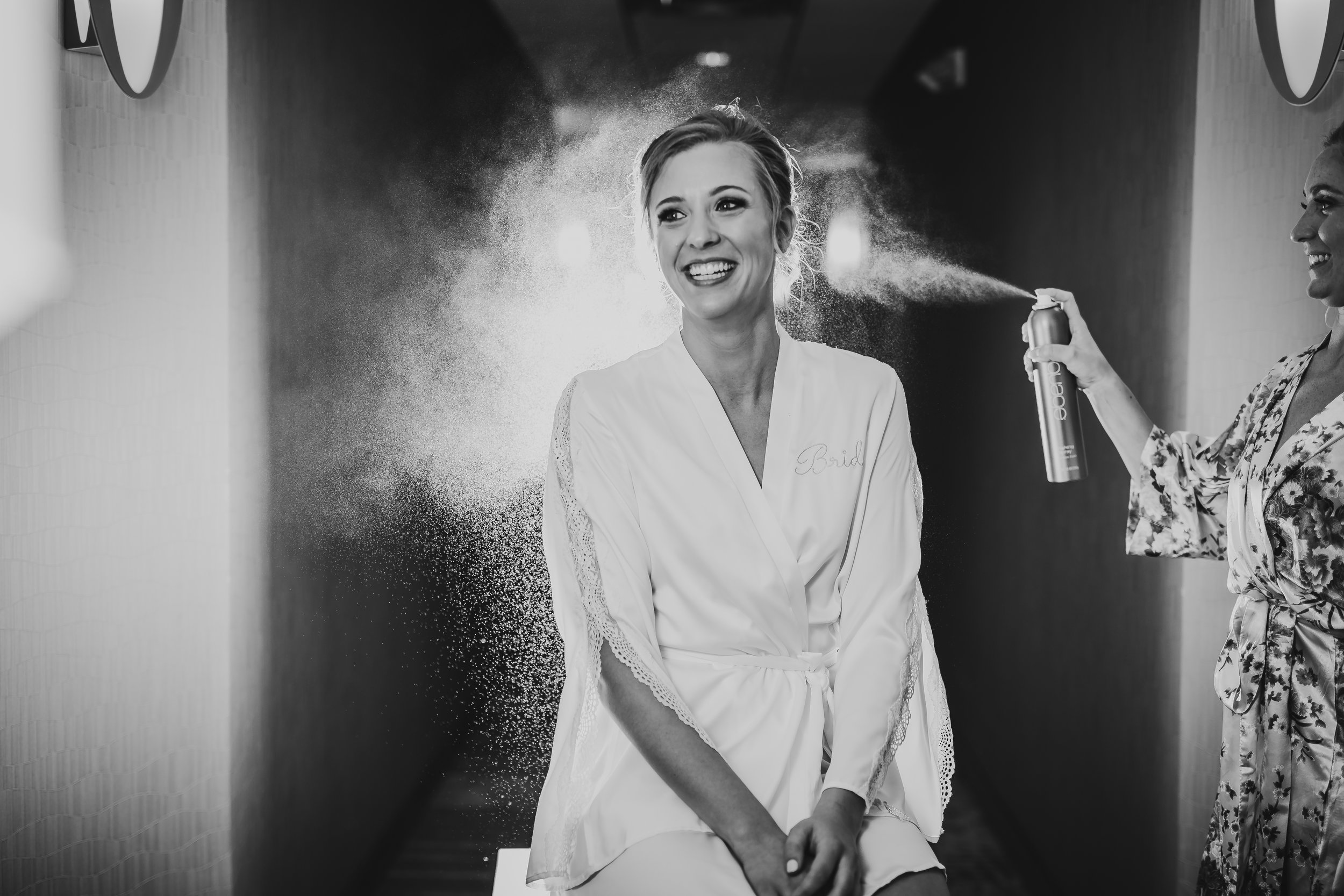 bride-getting-ready-in-hotel-lauren-ashley-studios-hair-spray-photo.jpg
