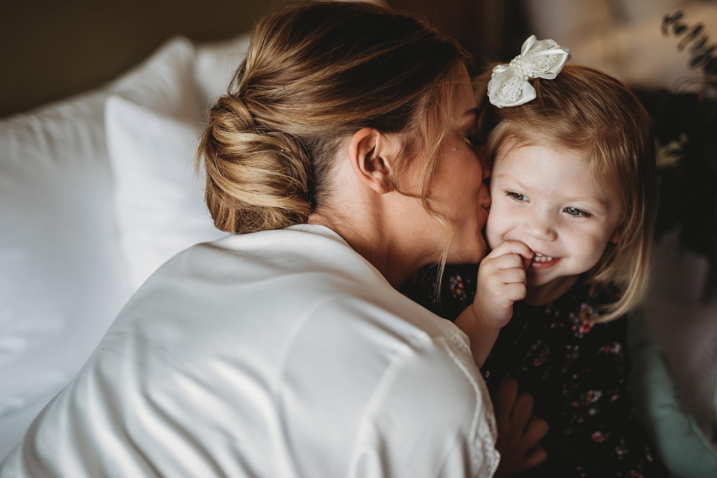 bride-getting-ready-in-hotel-lauren-ashley-studios-flowergirl.jpg