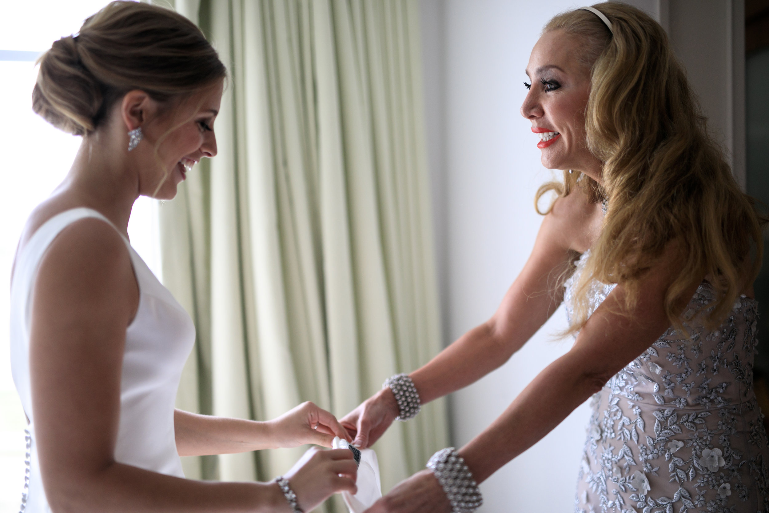 bride-getting-ready-in-hotel-lauren-ashley-studio-bride-with-mother-in-law.jpg