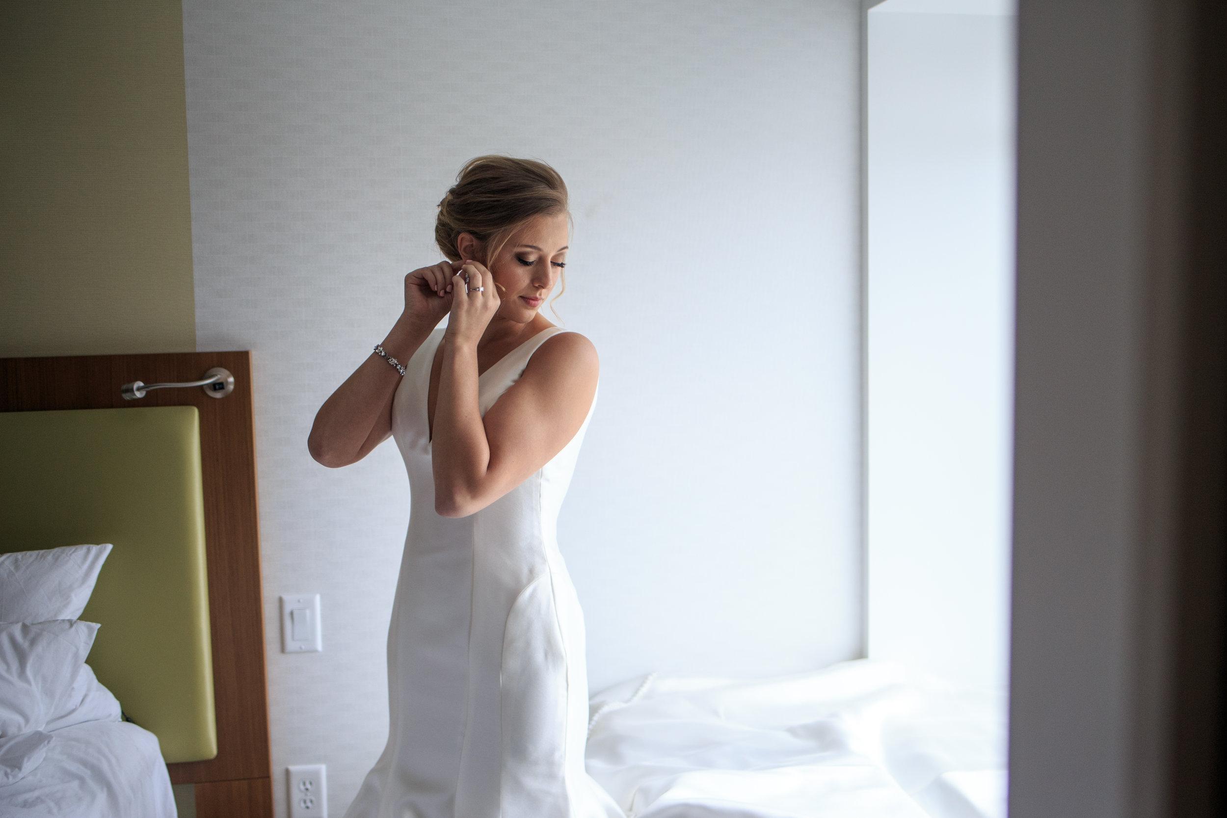 bride-getting-ready-in-hotel-lauren-ashley-studios.jpg