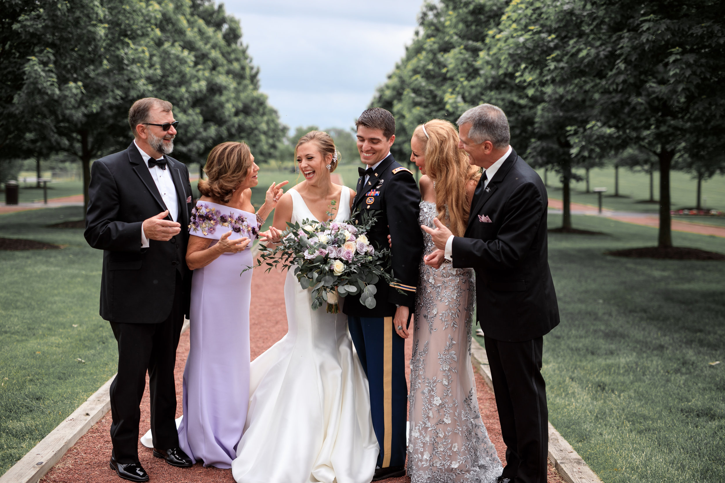 Bride-and-groom-with-family-on-wedding-day.jpg