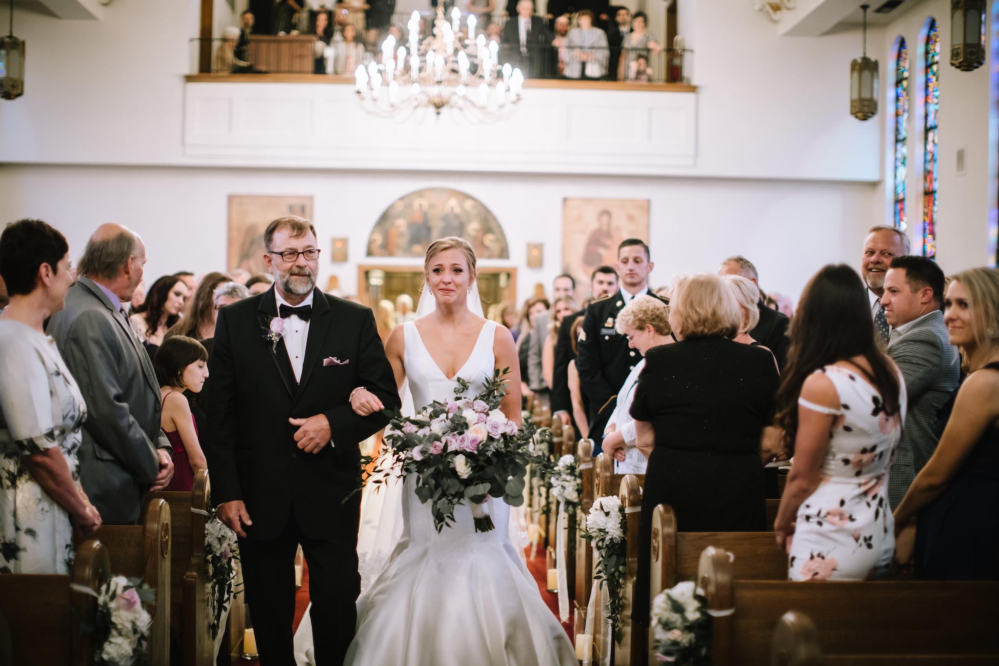bride-walking-down-the-aisle-lauren-ashley-studios.jpg