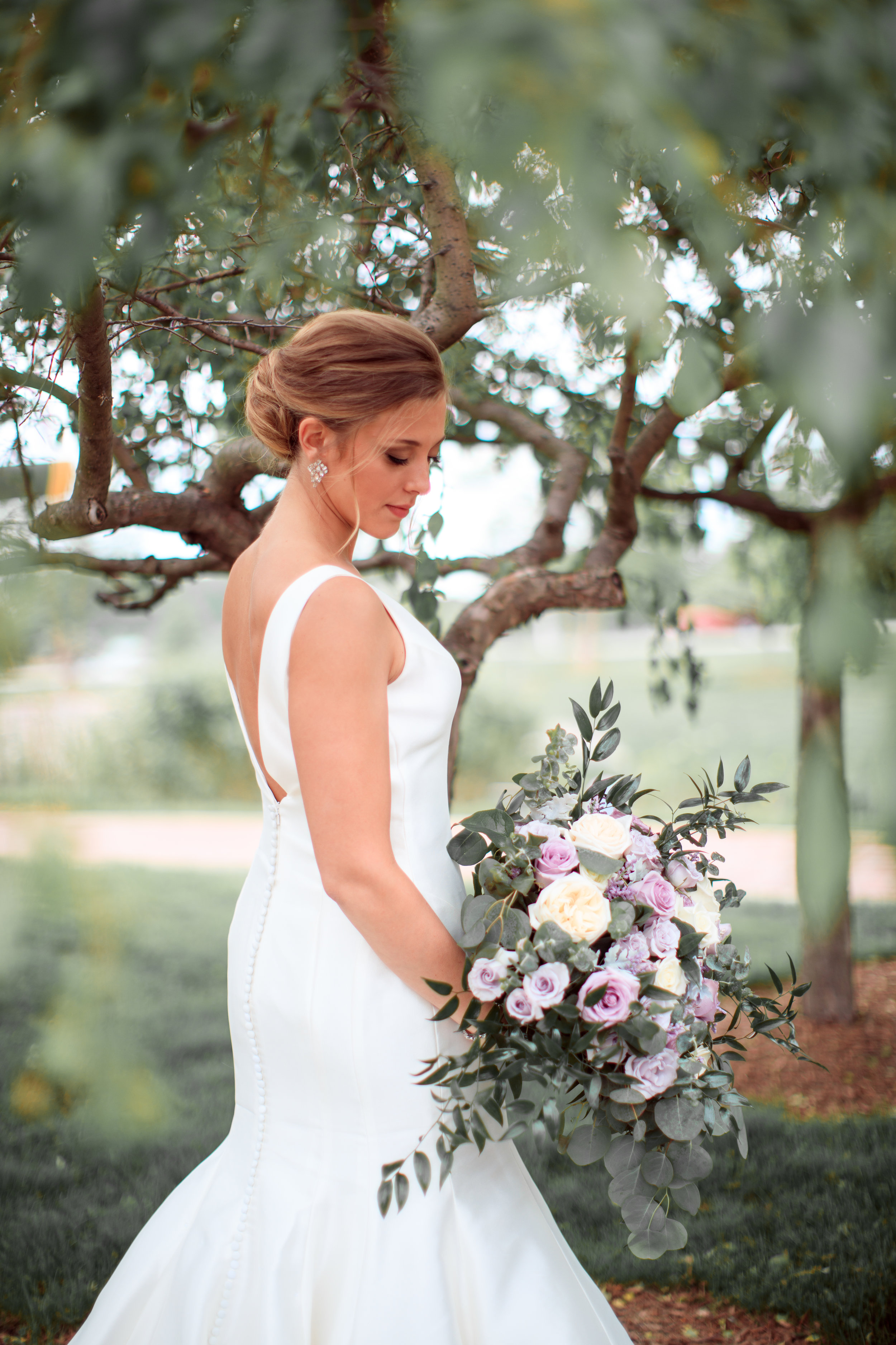 bride-with-stunning-flowers-from-kathys-florist.jpg