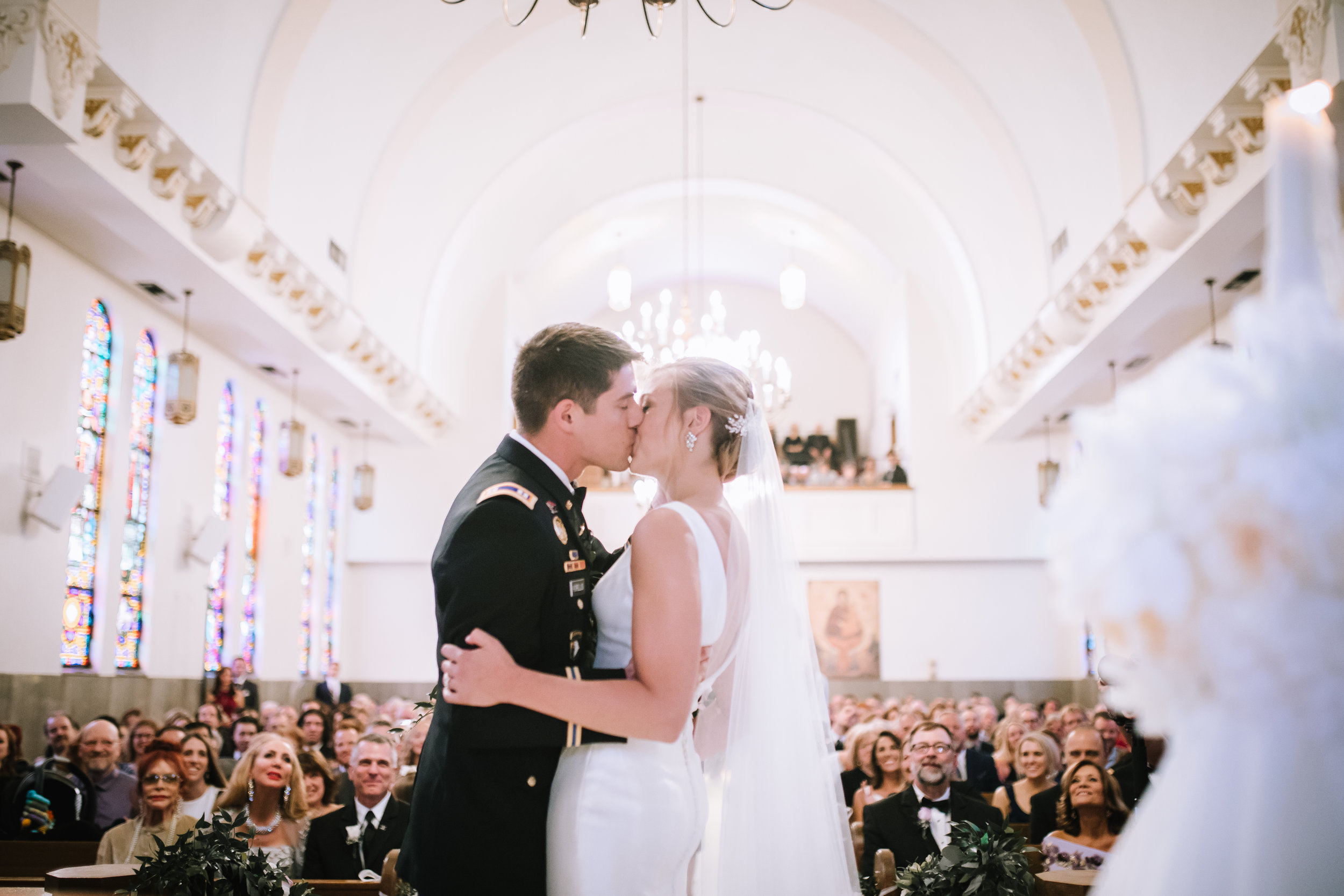 Wedding-first-kiss-with-guests-lauren-ashley-studios.jpg