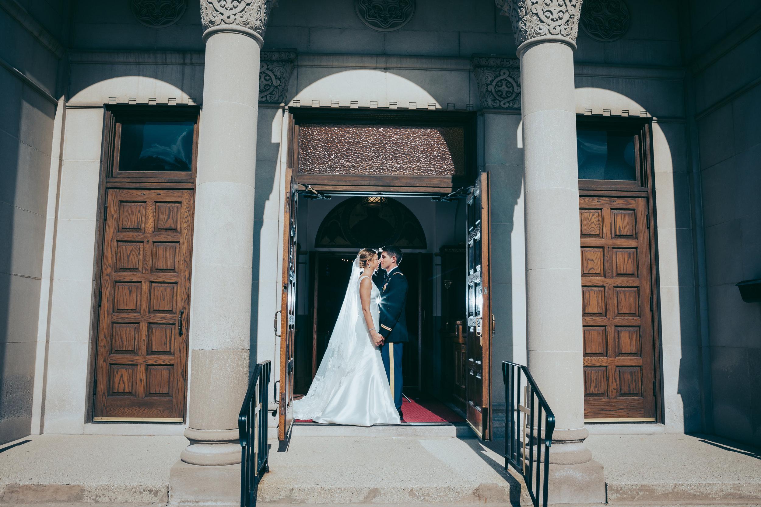 bride-and-groom-in-front-of-church-doors.jpg