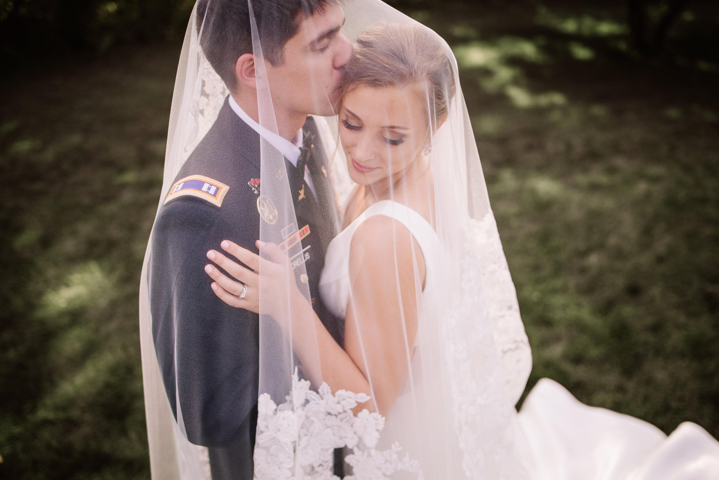 Bride-and-groom-wedding-pose-ideas-lauren-ashley-studios.jpg