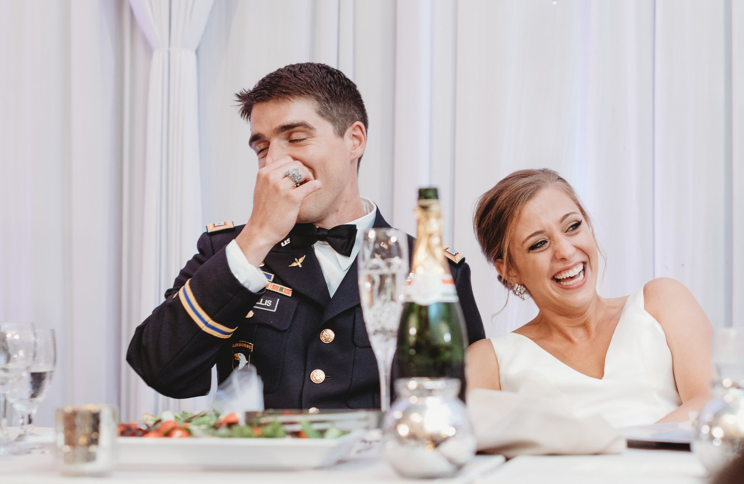 Bride-and-groom-laughing-during-speeches.jpg