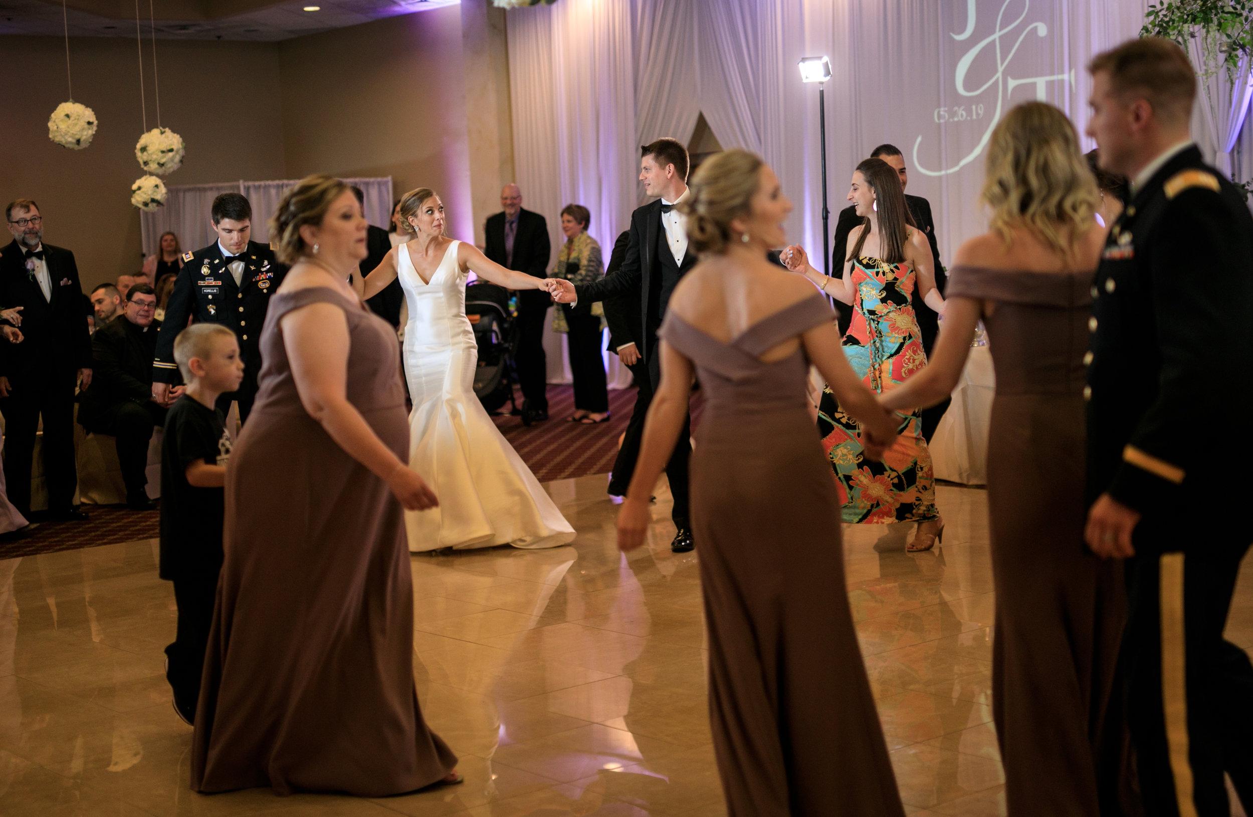 bride-and-groom-greek-dancing-at-weddig.jpg