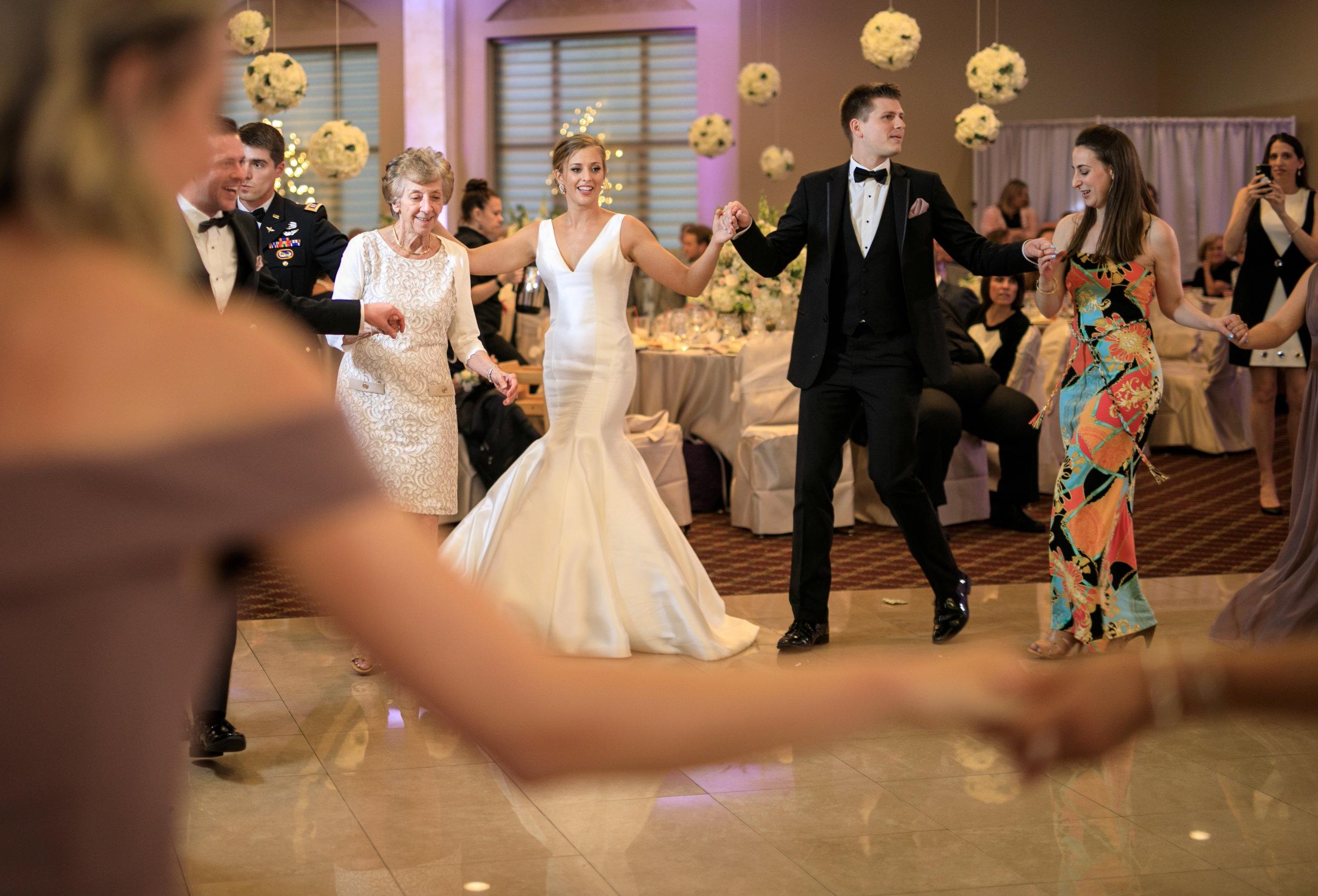 Bride-and-groom-greek-dancing-at-wedding.jpg