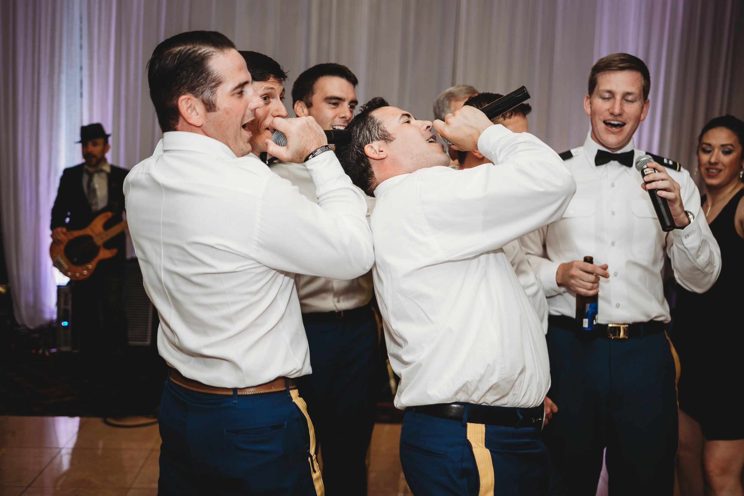 groomsmens-singing-to-bride.jpg