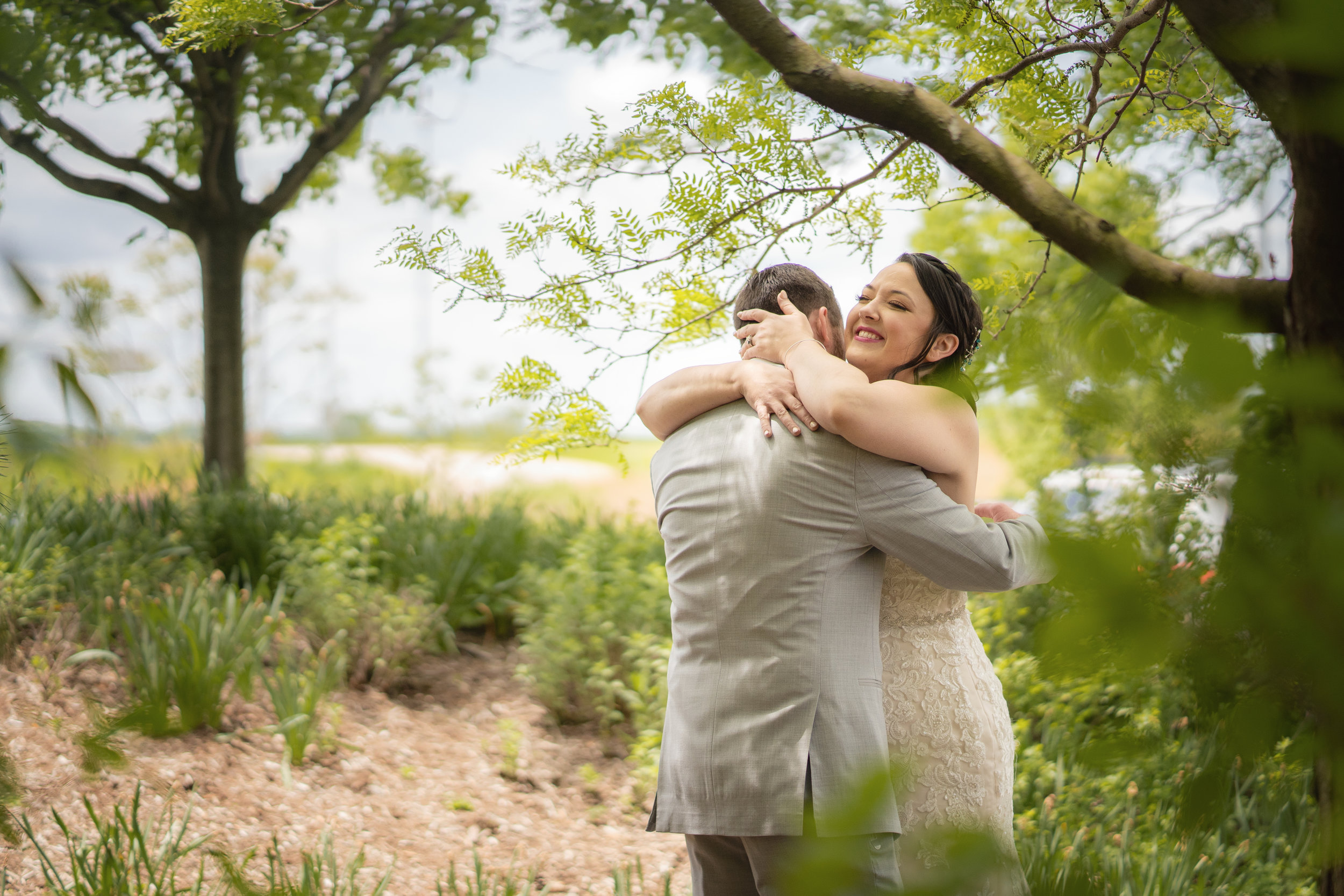 bride-groom-hugging-and-embracing-outdoors.jpg