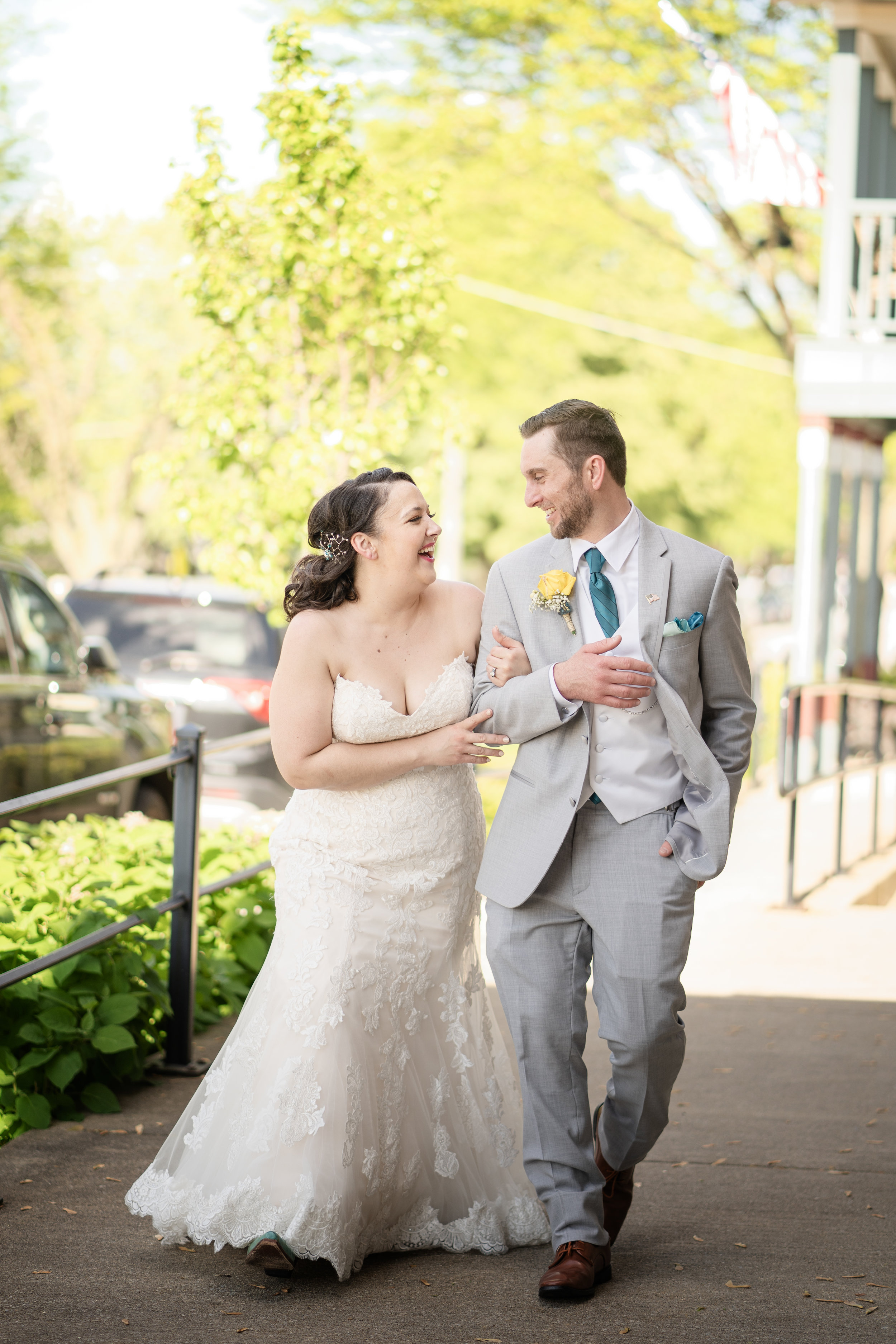 bride-groom-laughing-and-strolling-on-sidewalk.jpg