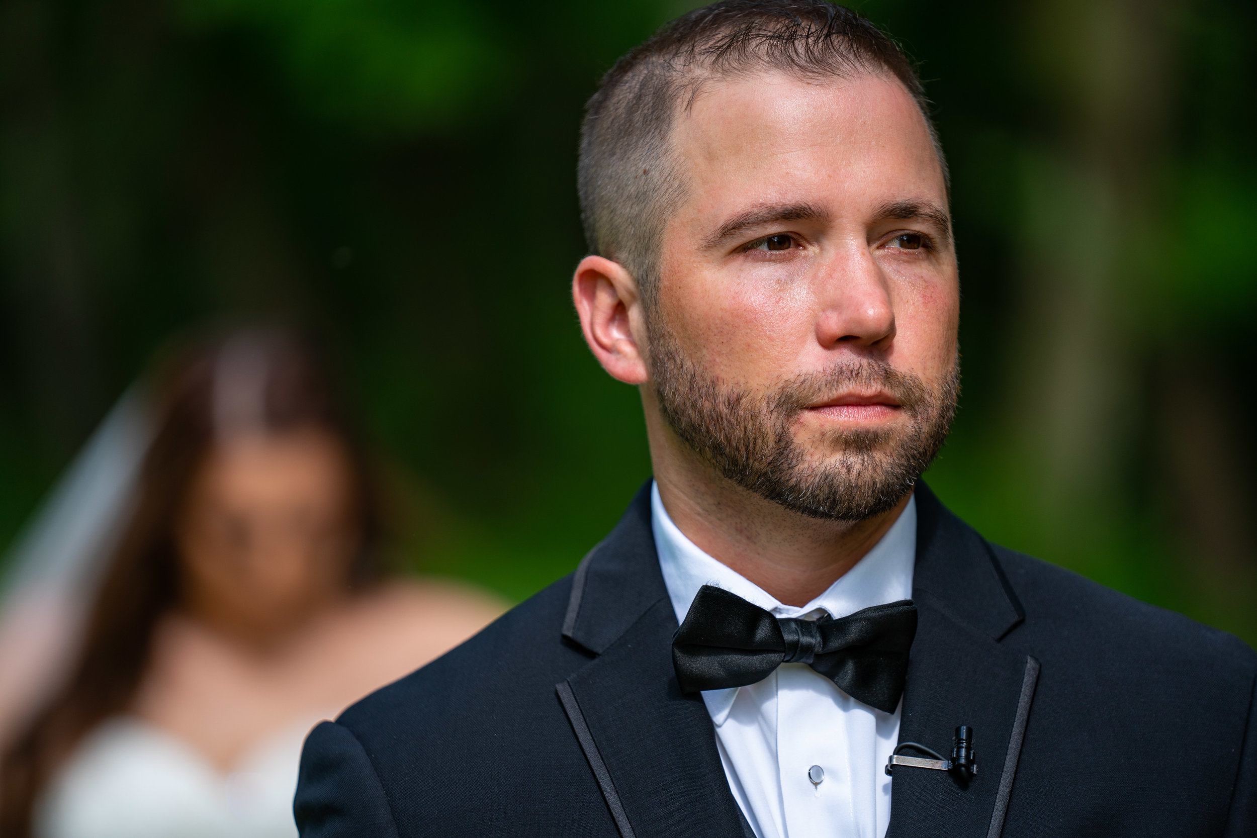 groom-bride-in-background-first-look-wedding-photography.jpg