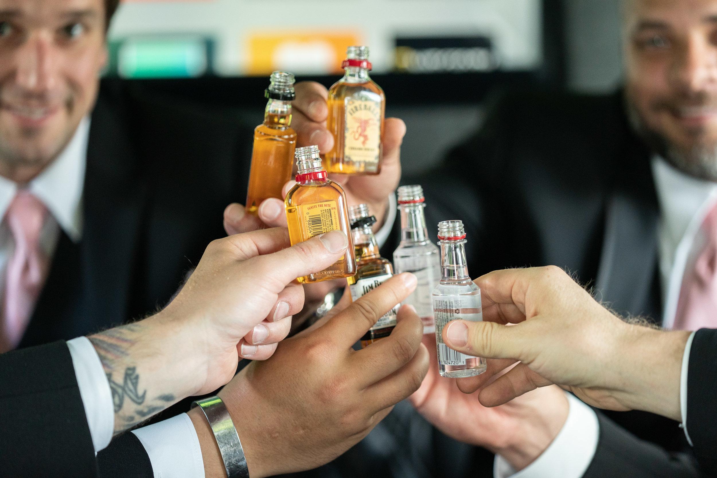 groomsmen-party-bus-limo-celebrating-marriage-cheers.jpg