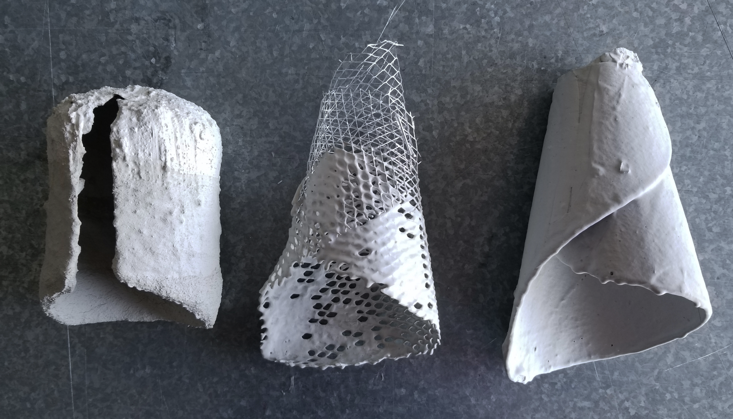 The first material test, left, is a metal mesh shell dipped in 3 concrete mixtures   Test two, middle, is also a metal mesh, but dipped into a diluted cement and gypsum mixture  Test three demonstrates material interaction with template shape, right, is a rag paper shell template dipped twice into the mixture from test two