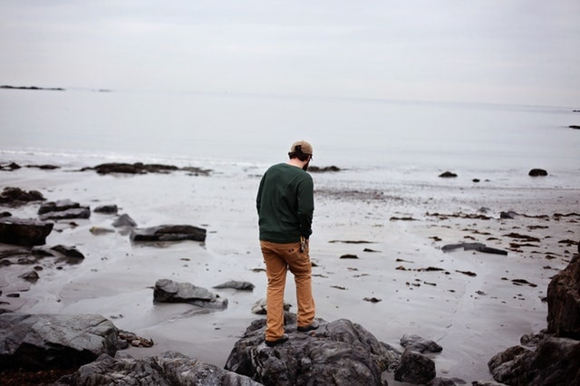 WELLIVER-beach-coast-man-walking-alonejpg-min.jpg