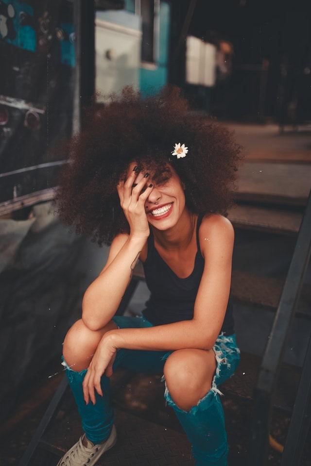 WELLIVER-teen-smiling-flower-in-hair-min.jpg