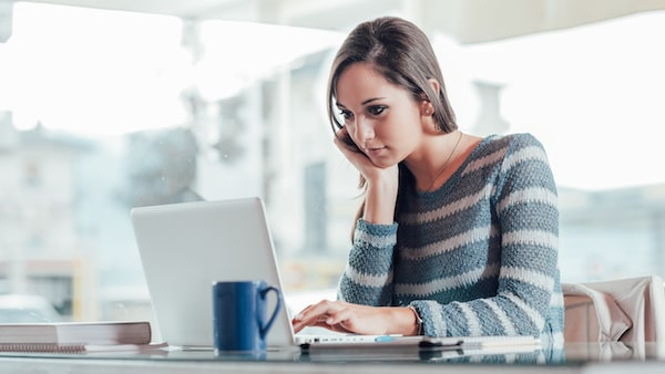 WELLIVER-woman-on-computer-in-blue-sweater-min.jpeg