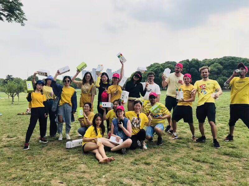 The victorious Yellow Team celebrating with their prizes, high-quality reusable water bottles!