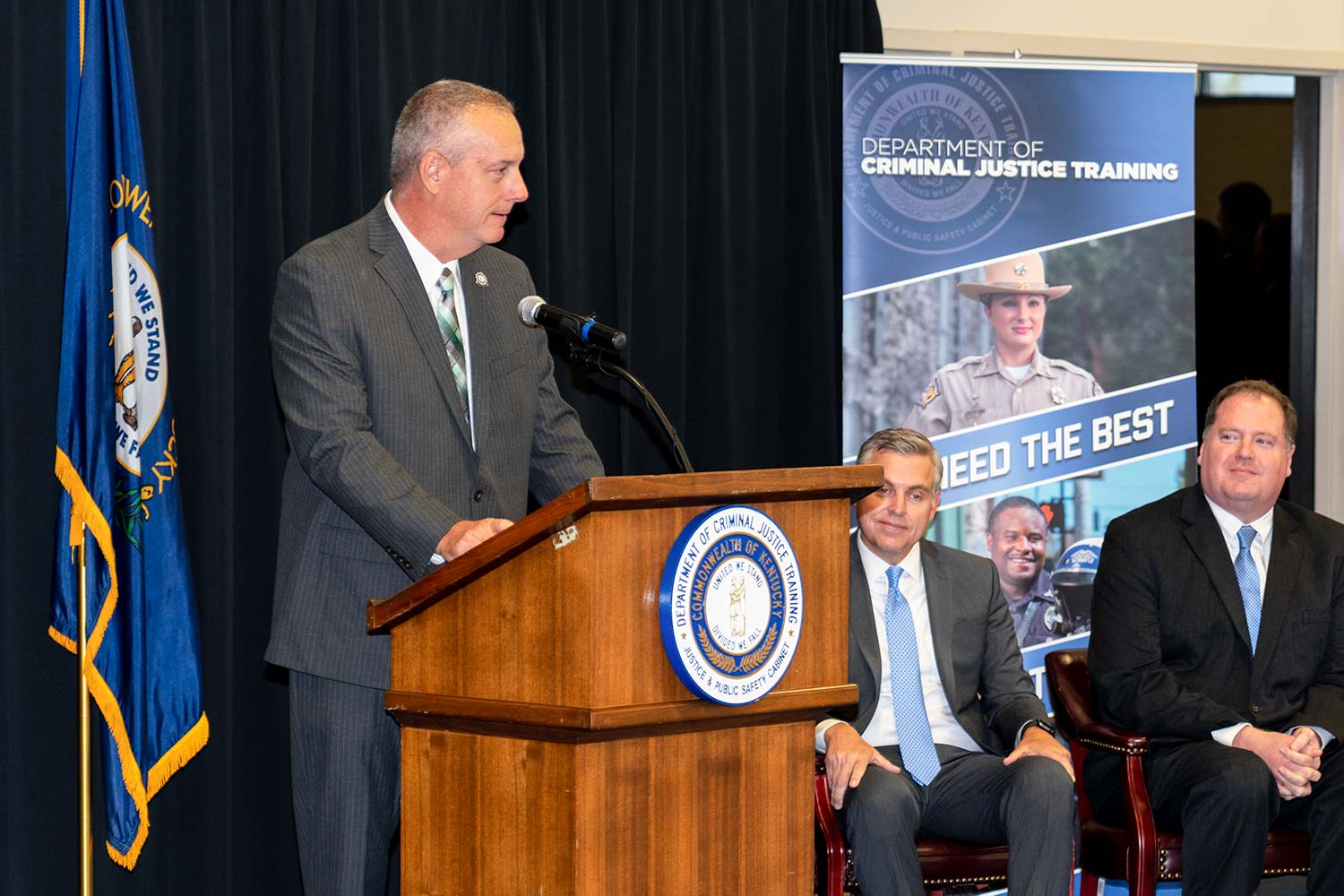 Department of Criminal Justice Training Commissioner Alex Payne speaks to attendees. (Photo by Jim Robertson)