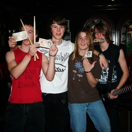 The first paid gig for, Defunct, one of the many bands!
