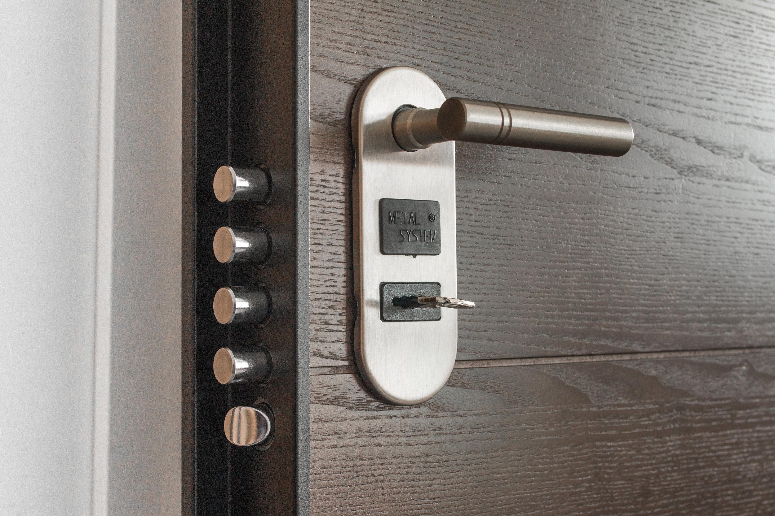 https://www.canva.com/photos/MADGxypViHE-deadlock-with-key-on-hole/