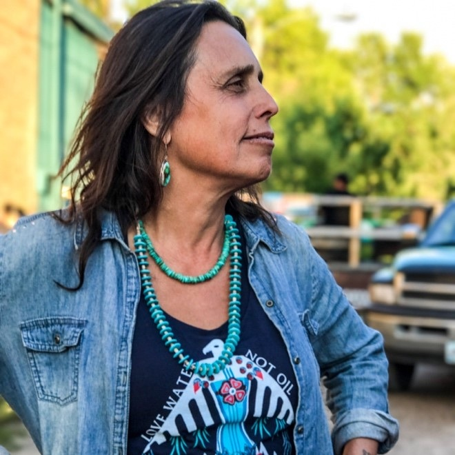 Winona LaDukeFounder - Winona LaDuke is a rural development economist and author working on issues of Indigenous Economics, Food and Energy Policy. She co-founded Honor the Earth with the Indigo Girls, as a platform to raise awareness of and money for indigenous struggles for environmental justice. Globally and nationally, Winona is known as a leader in the issues of cultural-based sustainable development strategies, renewable energy, and sustainable food systems. She is one of the leaders in the work of protecting Indigenous plants and heritage foods from patenting and genetic engineering.
