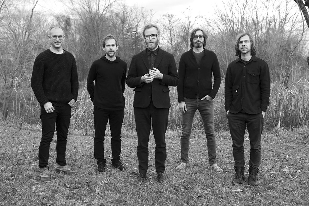 """The National, a band that """"has long wallowed in the muck of domestic life."""""""