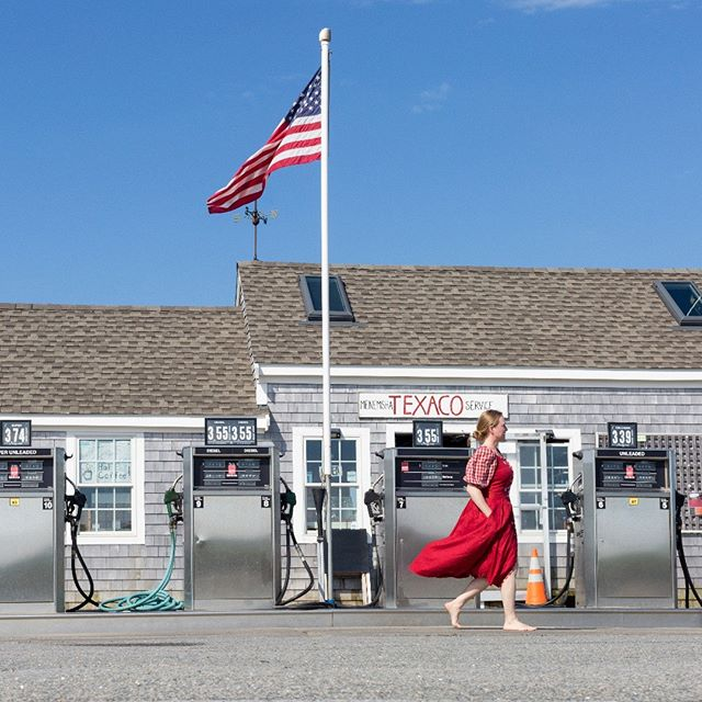 © Lisa Vollmer. A Self-Portrait in Martha's Vineyard.  16 x 24 inch framed archival pigment print - on view in the gallery : : #selfportrait #marthasvineyard #menemsha #americansymbols #gasoline #gasolinestation #americanflag #german #american #culturalheritage #culturalexchange #fineartphotography #photography