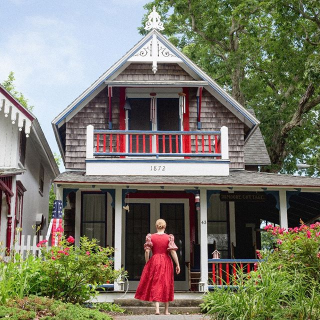 © Lisa Vollmer, 2019. A Self-Portrait on Martha's Vineyard. Oak Bluffs, Massachusetts. : : #selfportrait #fineartphotography #marthasvineyard #oakbluffs #cottage #red #white #blue #reddress #culturalexchange #culturalheritage #vello #canon #solo #solotravel #home