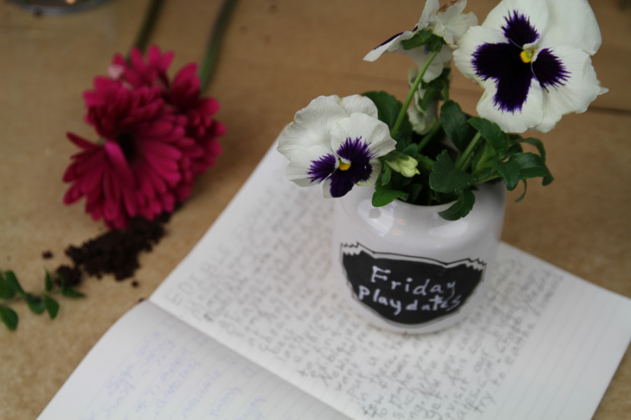 All you need is a food safe pot, edible flowers or herbs, and crumbled cake or brownies