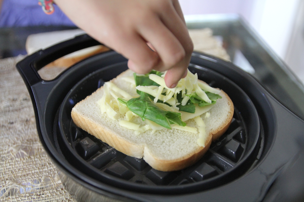 Sprinkle a thin layer of cheese & veggies on bread