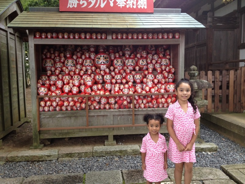 Daruma, good luck charms, outside a temple in Japan