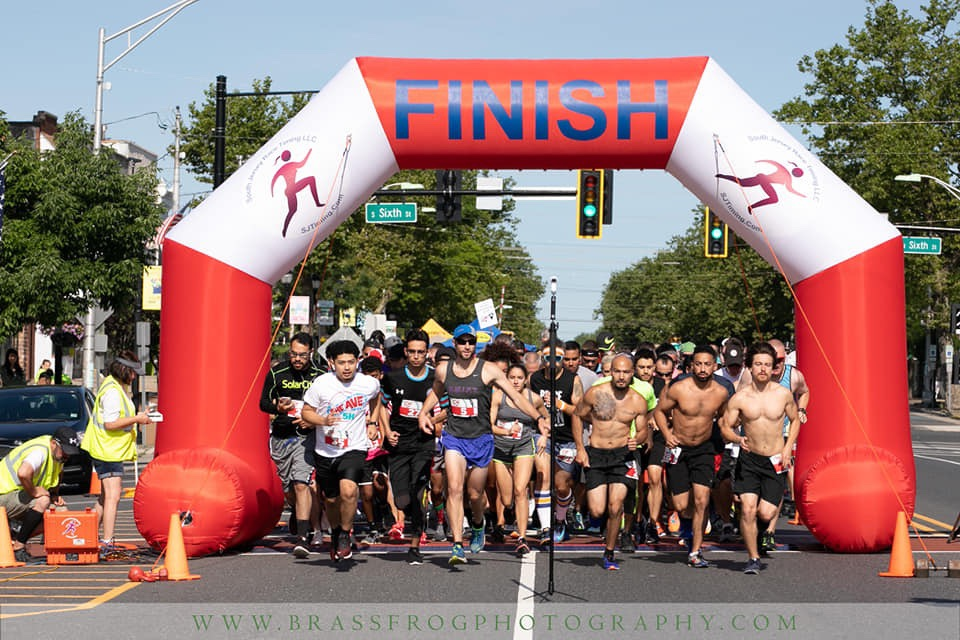 Photo of the start of the inaugural Running THE AVE 5K. Our flagship race