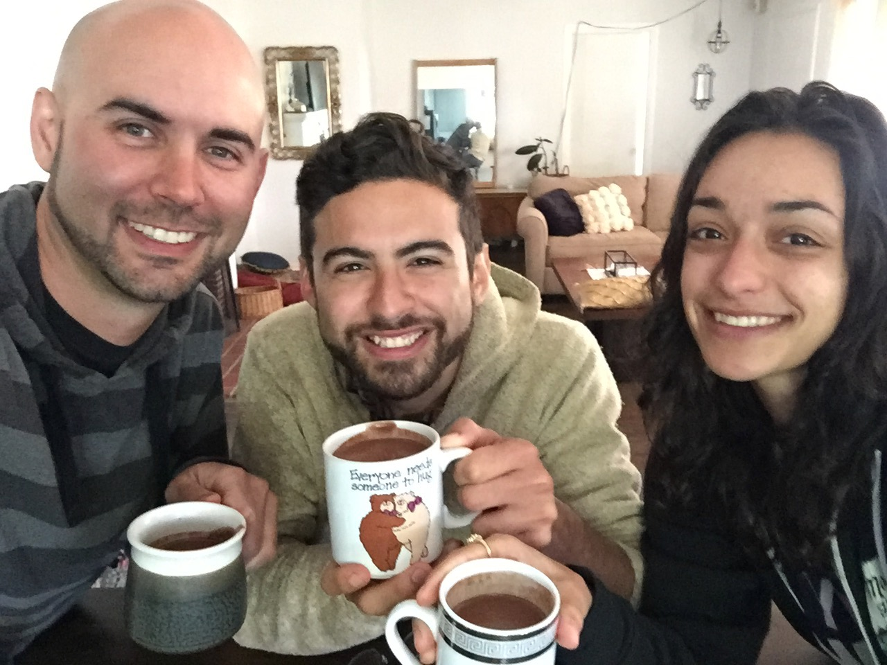 Soul Lift Cacao founder Nick Meador (left) enjoys ceremonial cacao with friends