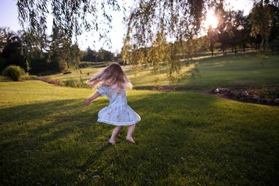 twirling dress girl grass